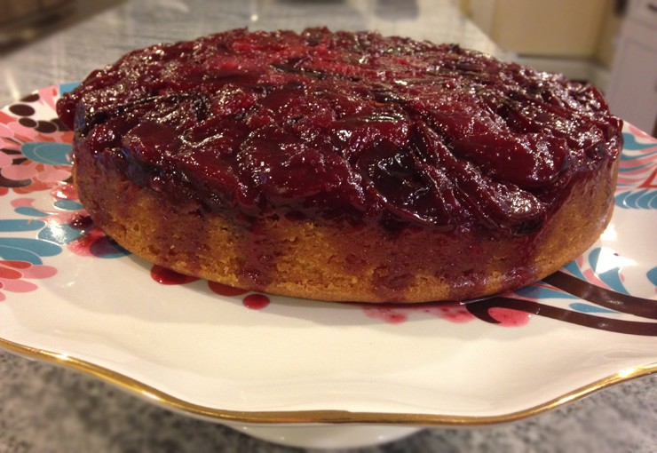 Finished plum upside down cake on a serving plate
